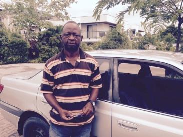 Monsieur Fredy, trustful taxi driver in Kinshasa